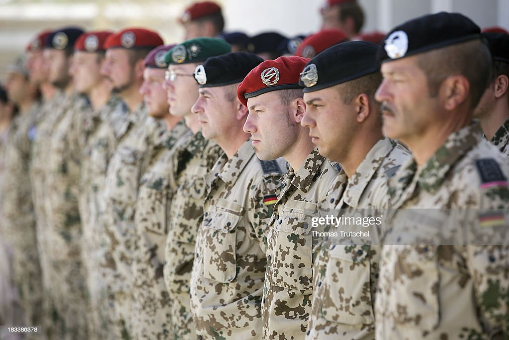 German Soldiers stand in a line during a ceremonial handover at PRT Kunduz on October 06, 2013 in Kunduz, Afghansitan. Westerwelle and de Maiziere visit Afghanistan to hand over German PRT in Kunduz to the Afghan Military.