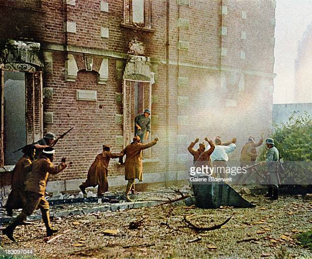 German soldiers taking French soldiers of African origin prisoner during the Battle of France June 1940 The invasion started on 10th May 1940 and...