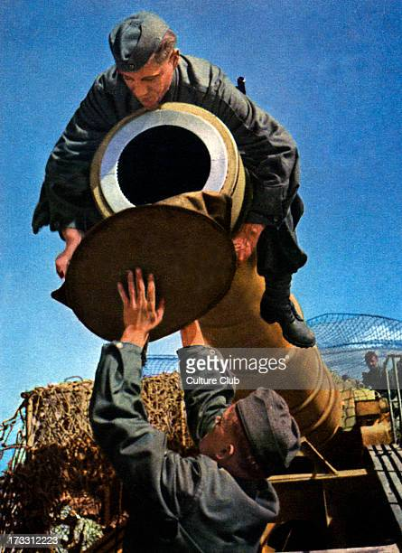 German soliders removing cap of a railway gun during World War 2 Spanish postcard intended for supporters of Franco' s Republic which was in favour...