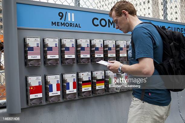 German speaking tourist reads a pamphlet guide to the 911 Memorial site June 6 2012 in New York City An estimated 16000 to 18000 tourists visit the...