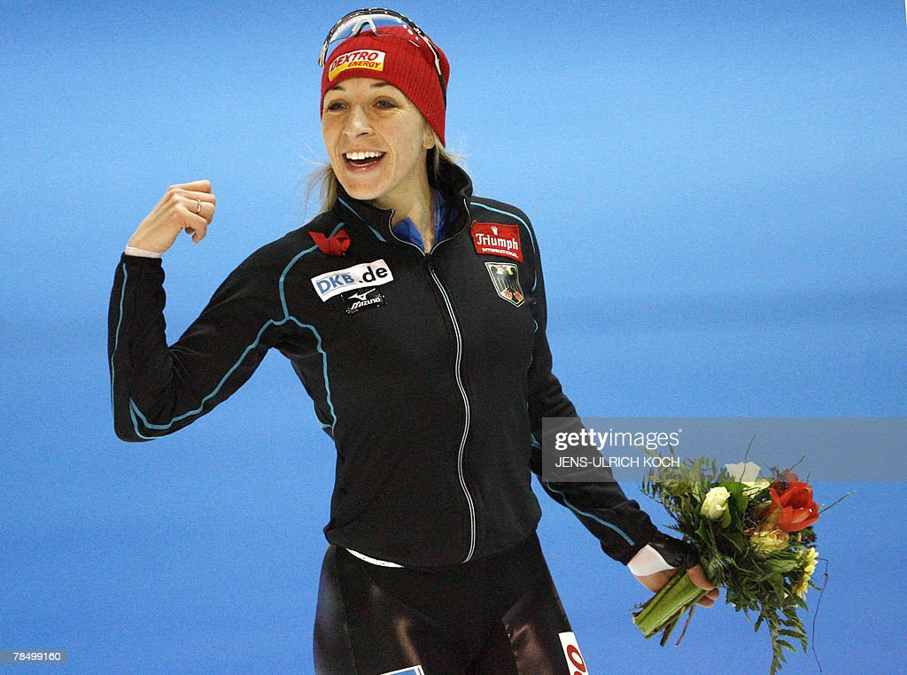 German speed skater Anni Friesinger celebrates after winning the women's 1000m race and her career's 50th world cup victory, 15 December 2007 during the of the speed Skating World Cup at the Gunda-Niemann-Stirnemann-Hall in the eastern town of Erfurt. German Anni Friesinger won ahead of Italian Chiara Simonato and Canadian Cindy Klasssen.