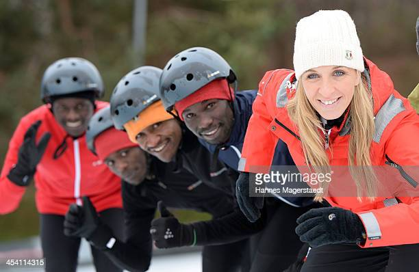 German speedskater Anni Friesinger and the marathon runners Amos Isaac Sammy and Leonard attend 'Real Cool Runnings' Photocall on December 7 2013 in...