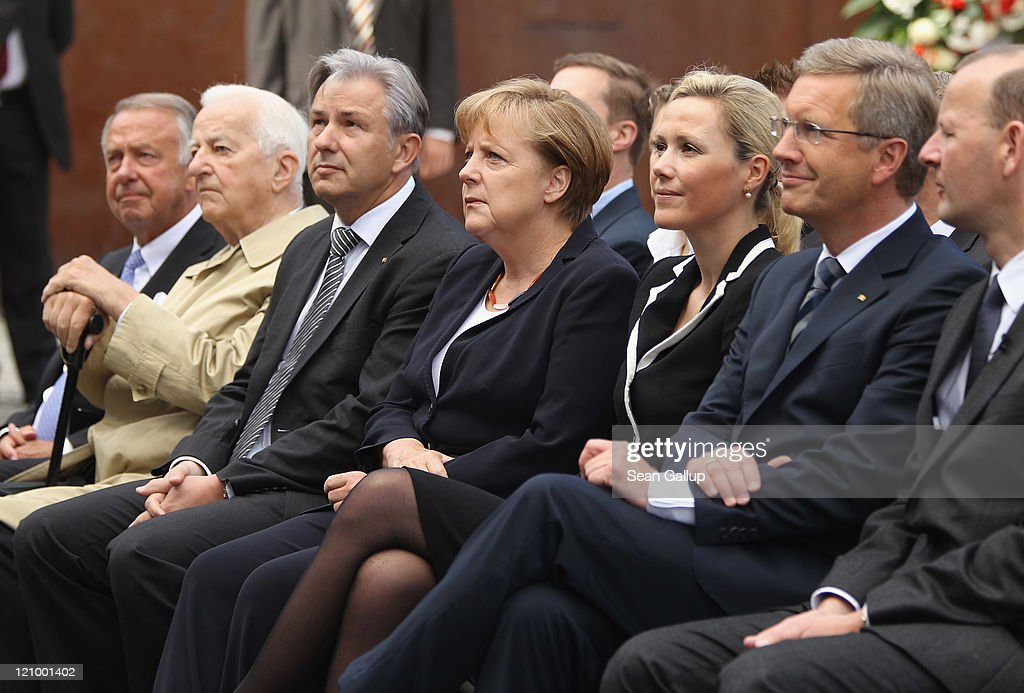 German State Cultural Minister <a gi-track='captionPersonalityLinkClicked' href=/galleries/search?phrase=Bernd+Neumann&family=editorial&specificpeople=598616 ng-click='$event.stopPropagation()'>Bernd Neumann</a>, former President Richard von Weizsaecker, Berlin Mayor <a gi-track='captionPersonalityLinkClicked' href=/galleries/search?phrase=Klaus+Wowereit&family=editorial&specificpeople=213527 ng-click='$event.stopPropagation()'>Klaus Wowereit</a>, Chancellor <a gi-track='captionPersonalityLinkClicked' href=/galleries/search?phrase=Angela+Merkel&family=editorial&specificpeople=202161 ng-click='$event.stopPropagation()'>Angela Merkel</a>, First Lady <a gi-track='captionPersonalityLinkClicked' href=/galleries/search?phrase=Bettina+Wulff&family=editorial&specificpeople=5780590 ng-click='$event.stopPropagation()'>Bettina Wulff</a> and German President <a gi-track='captionPersonalityLinkClicked' href=/galleries/search?phrase=Christian+Wulff&family=editorial&specificpeople=221618 ng-click='$event.stopPropagation()'>Christian Wulff</a> attend a ceremony commemorating the 50th anniversary of the construction of the Berlin Wall at the Bernauer Strasse memorial on August 13, 2011 in Berlin, Germany. The Berlin Wall, equipped with watch towers, armed guards and trip-wire triggered machine guns, was originally built in 1961 by the communist authorities of East Germany in order to stop East Germans from fleeing into West Berlin. At least 136 people died trying to do so until the Wall came down in 1989.