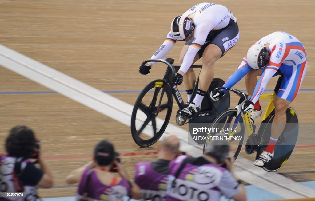 German Stefan Botticher (L) crosses a finish line for the gold ahead of Russian Denis Dmitriev during Men's Sprint event of the UCI Track Cycling World Championships in Minsk on February 24, 2013.