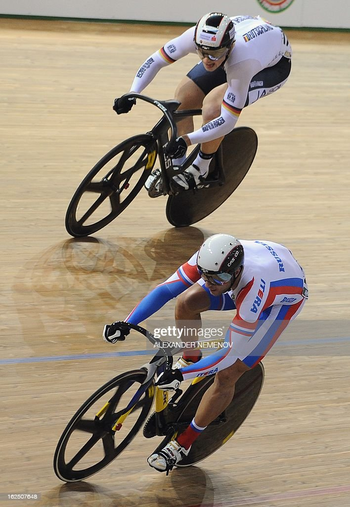 German Stefan Botticher (top), gold, and the silver medalist Russian Denis Dmitriev compete during Men's Sprint event of the UCI Track Cycling World Championships in Minsk on February 24, 2013.