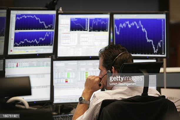 MAIN German stock exchange Frankfurt Main Thoughtful broker in front of his computer displays in the trading floor of the Frankfurt stock exchange...