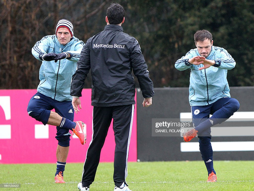 German striker Mario Gomez and Germany's defender Heiko Westermann attend a training session of the German national football team prior to the World Cup qualifier against Kazakhstan in Frankfurt, Germany, on March 20, 2013.