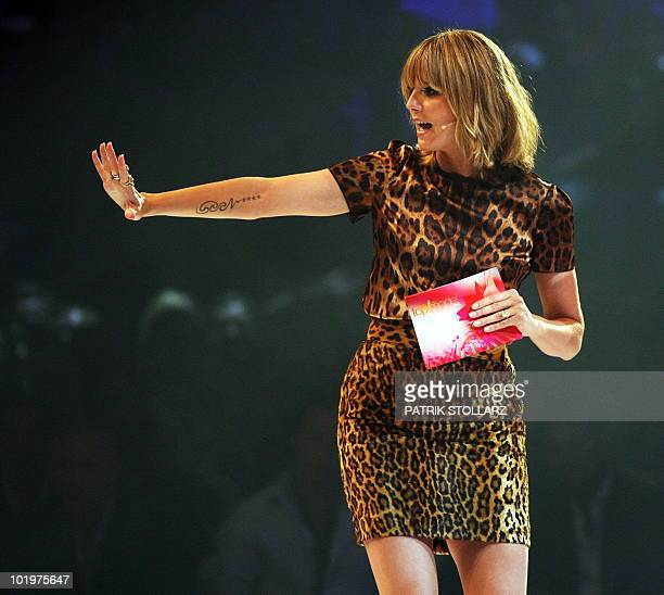 German supermodel Heidi Klum gestures during her TVshow 'Germany's Next Top Model' during the final decision of the contest on June 10 2010 at the...