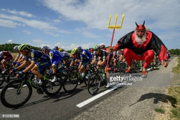 TOPSHOT German supporter Didi Senft known as El Diablo jumps as the pack ride during the 2135 km seventh stage of the 104th edition of the Tour de...