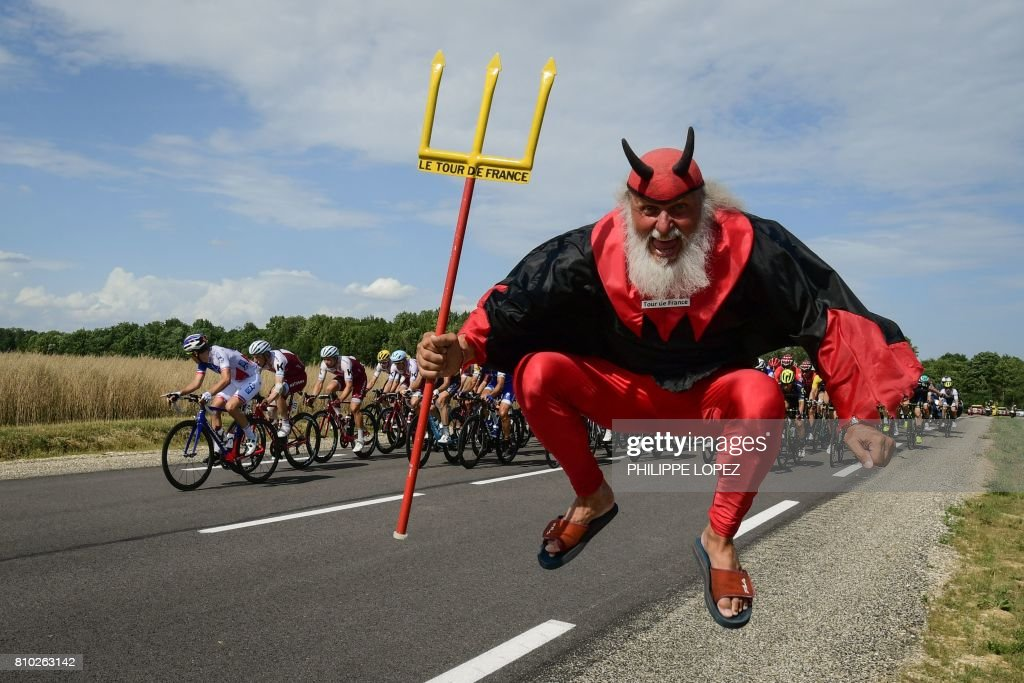 German supporter Didi Senft known as El Diablo jumps as the pack ride during the 213,5 km seventh stage of the 104th edition of the Tour de France cycling race on July 7, 2017 between Troyes and Nuits-Saint-Georges. /