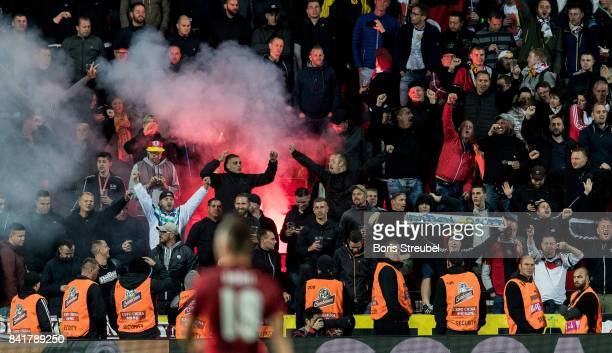 German supporters light flares during the FIFA 2018 World Cup Qualifier between Czech Republic and Germany at Eden Stadium on September 1 2017 in...