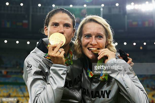 German team captain Saskia Bartusiak of Germany and Annike Krahn of Germany celebrate with their medals following victory in the Women's Olympic Gold...