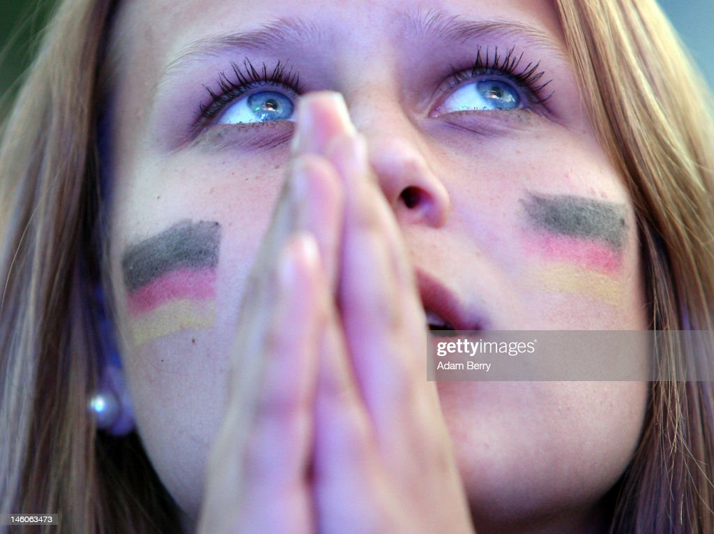 German team fan watches the Germany versus Portugal UEFA Champions League soccer match broadcast from Lviv Ukraine on a giant outdoor screen near the...
