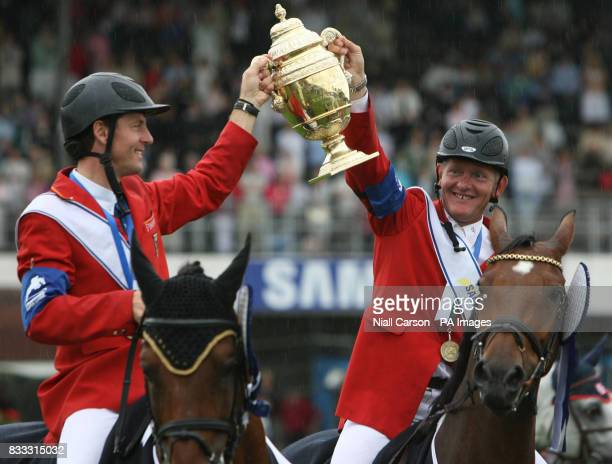 German team mates LR Thomas Muhlbauer and Engemann Hermann hold up the Aga Khan Challenge trophy at the Dublin Horse Show at the RDS in Dublin The...