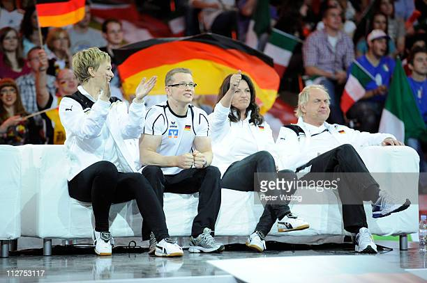 German team members Karen Heinrichs Fabian Hammbuechen Christine Neubauer and Uwe Ochsenknecht watch a game and celebrate a won point during the...