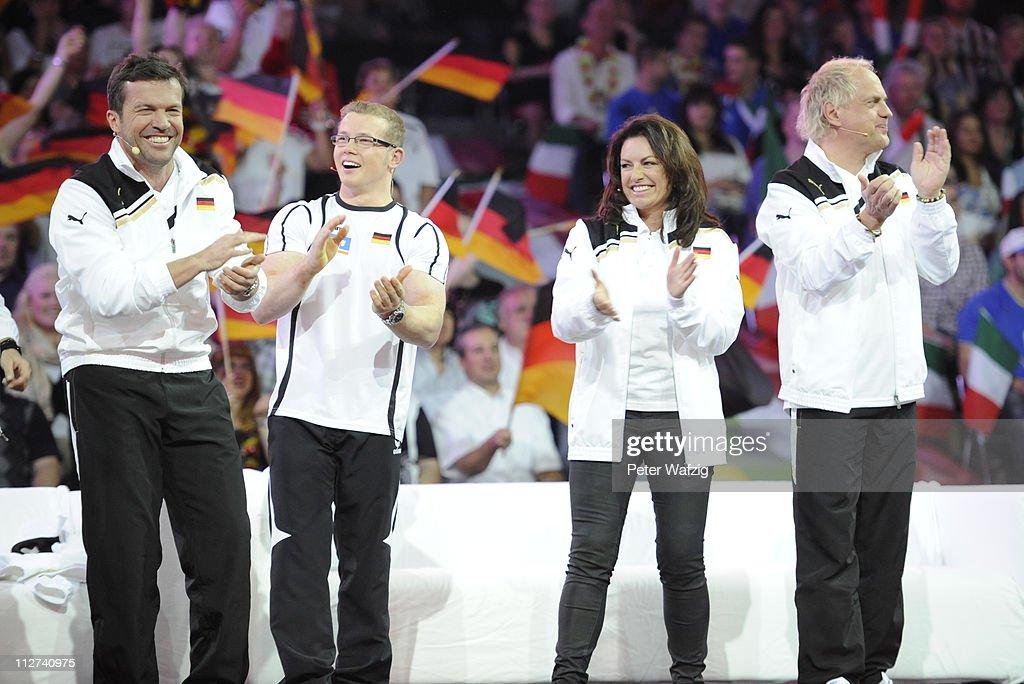 German team members Lothar Matthaeus Fabian Hambuechen Christine Neubauer and Uwe Ochsenknecht celebrate during the 'Deutschland Gegen Italien' TV...