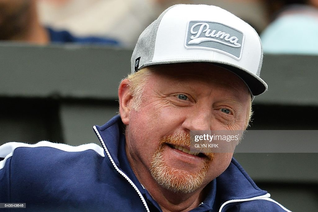 German tennis coach Boris Becker, Serbia's Novak Djokovic's coach, sits on centre court to watch Serbia's Novak Djokovic play against France's Adrian Mannarino during their men's singles second round match on the third day of the 2016 Wimbledon Championships at The All England Lawn Tennis Club in Wimbledon, southwest London, on June 29, 2016. / AFP / GLYN