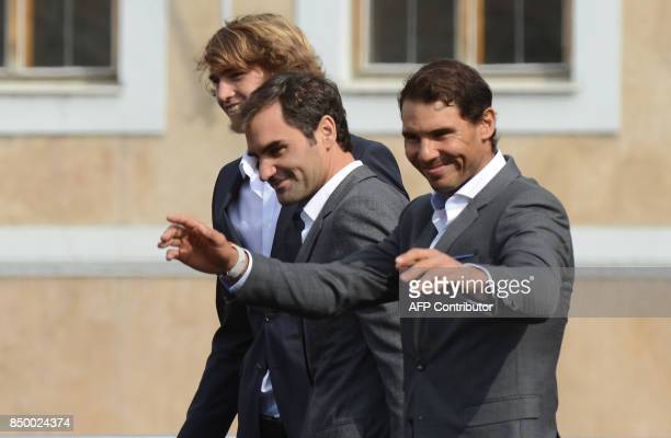 German tennis player Alexander Zverev Swiss tennis player Roger Federer and Spanish tennis player Rafael Nadal greet the audience from the stage...