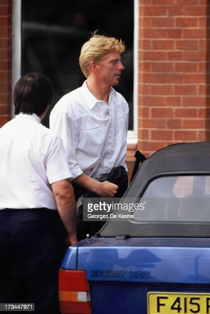 German tennis player Boris Becker gets in his car after winning in the Men's Singles at Wimbledon on July 1989