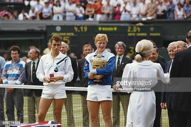 German tennis player Boris Becker holds the Gentlemen's Singles Trophy after defeating Ivan Lendl 64 63 75 in the final of the Men's Singles...