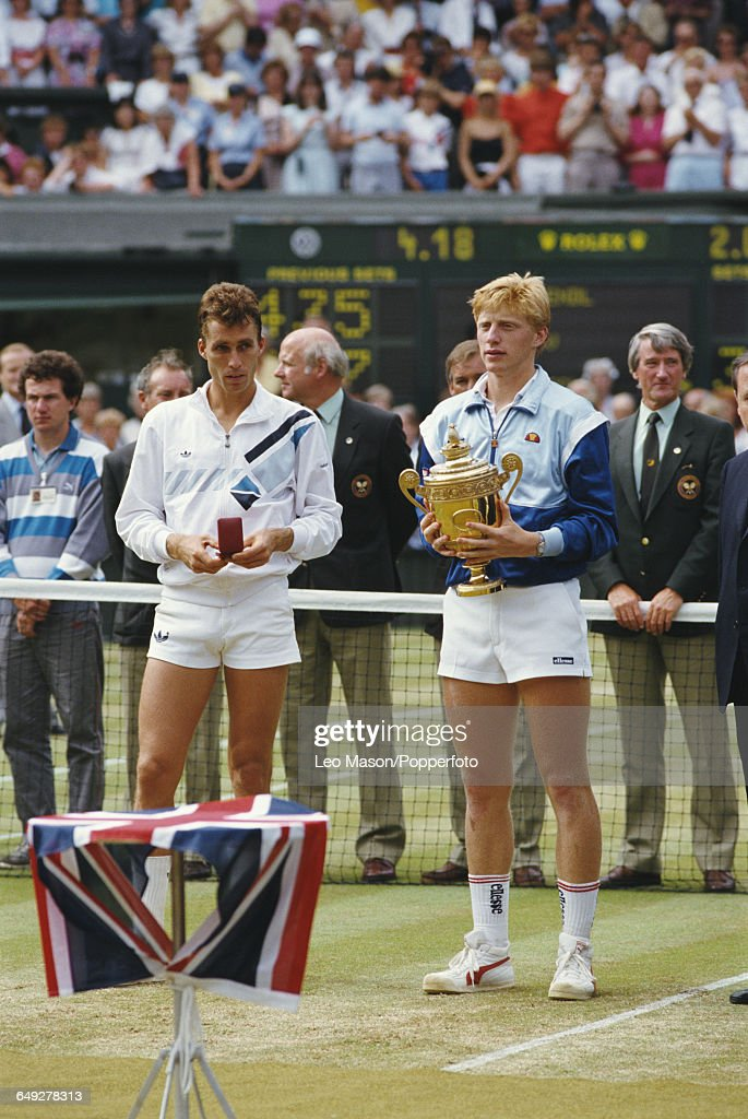 German tennis player Boris Becker holds the Gentlemen's Singles Trophy after defeating Ivan Lendl 64 63 75 in the final of the Men's Singles...