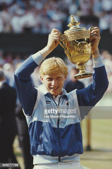 German tennis player Boris Becker holds up the Gentlemen's Singles Challenge Cup Trophy after defeating Kevin Curren in the final of the Men's...
