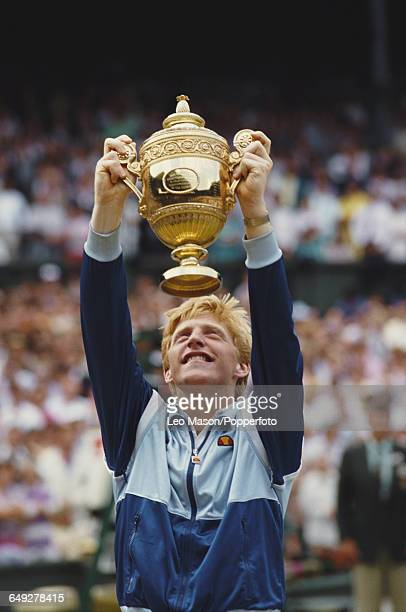 German tennis player Boris Becker holds up the Gentlemen's Singles Challenge Cup Trophy after defeating Ivan Lendl 64 63 75 in the final of the Men's...