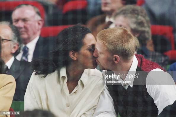 German tennis player Boris Becker kisses his future wife Barbara Feltus as they watch play at the 1993 Grand Slam Cup tennis tournament in Munich...
