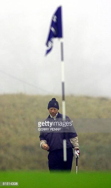 German tennis player Boris Becker lines up his putt on the 18th green at Kingsbarns Scotland 21 October 2001 in the Dunhill Links Golf Championship...