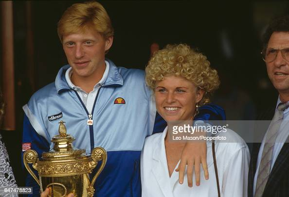German tennis player Boris Becker pictured holding the Gentlemen's Singles Challenge CupTrophy with his sister Sabine and father KarlHeinz Becker...