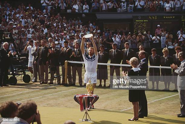 German tennis player Boris Becker pictured raising his runner's up plate in the air after being defeated by Pete Sampras in the final of the Men's...