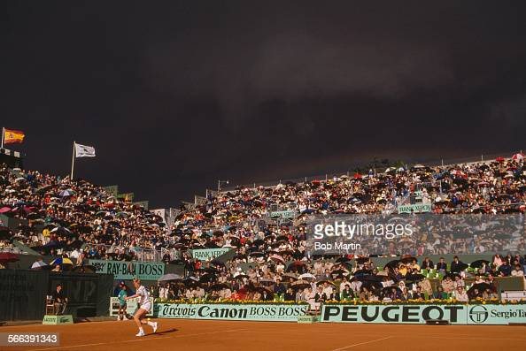 German tennis player Boris Becker plays a forehand shot during his semifinal match against Stefan Edberg of Sweden during the French Open at the...