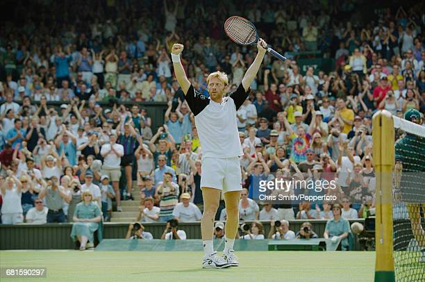 German tennis player Boris Becker raises his arms in the air in celebration after beating Australian tennis player Lleyton Hewitt to win their third...