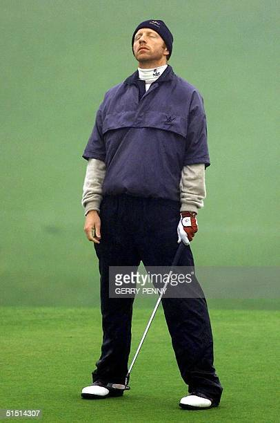 German tennis player Boris Becker reacts after missing a putt on the 18th green at Kingsbarns Scotland 21 October 2001 in the Dunhill Links Golf...