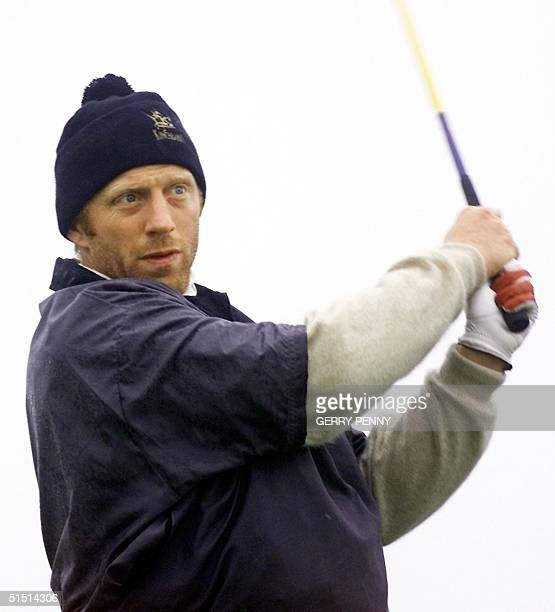 German tennis player Boris Becker tees off on the 18th at Kingsbarns Scotland 21 October 2001 in the Dunhill Links Golf Championship The links...