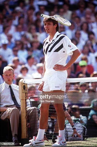 German tennis player Michael Stich balances his racket on his head as he shows his frustration during his match against fellow German player Boris...