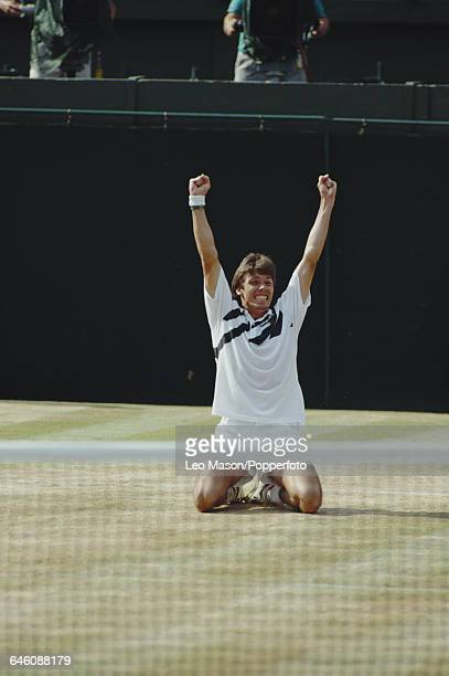 German tennis player Michael Stich celebrates after defeating Boris Becker in the final of the Men's Singles tournament to become champion at the...