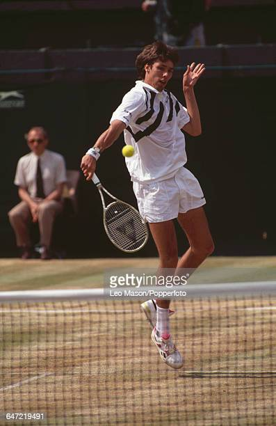 German tennis player Michael Stich pictured in action competing to become champion in the final of the Men's Singles tournament at the Wimbledon Lawn...