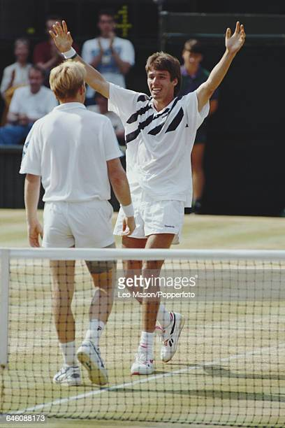 German tennis player Michael Stich walks forward to embrace fellow German player Boris Becker after beating Becker in the final of the Men's Singles...