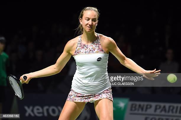 German tennis player Mona Barthel returns the ball to Czech tennis player Barbara Zahlavova Strycova during the quarterfinal tennis match at the...