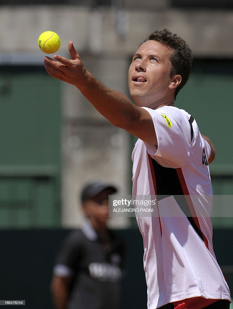 German tennis player Philipp Kohlschreiber serves to Argentina's Carlos Berlocq during their 2013 Davis Cup World Group first round single tennis match, at Parque Roca stadium in Buenos Aires on February 1, 2013.