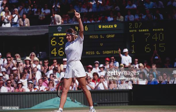 German tennis player Steffi Graf raises one arm in the air in celebration after winning the final of the Women's Singles tournament against Gabriela...