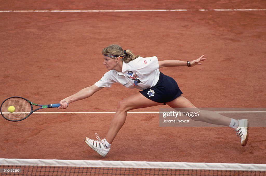 German tennis player Steffi Graf runs for a forehand at the net during the 1993 French Open.