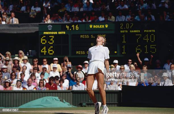 German tennis player Steffi Graf shouts in the air in celebration after winning the final of the Women's Singles tournament against Gabriela Sabatini...