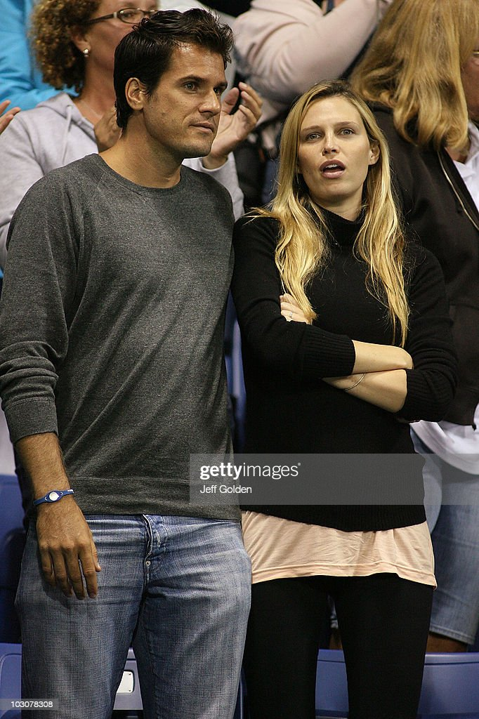 German tennis player Tommy Haas and girlfriend actress Sara Foster stand for introductions during the Stars Under the Stars gala on July 24 2010 at...