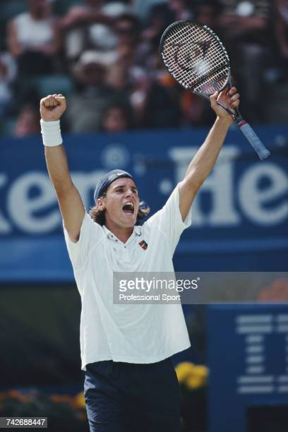 German tennis player Tommy Haas raises both arms in the air in celebration during progress to reach the semifinals of the Men's Singles tennis...