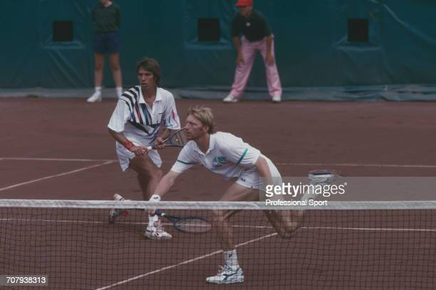 German tennis players Boris Becker and Michael Stich pictured in action during competition to finish in first place to win the gold medal in the...