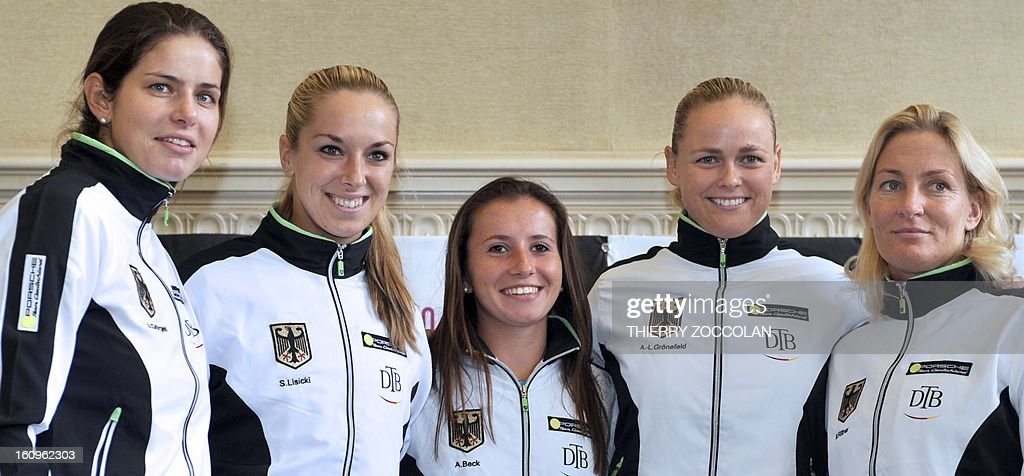German tennis players (from L) Julia Goerges, Sabine Lisicki, Annika Beck, Anna Lena Groenefeld and team captain Barbara Rittner pose on February 8, 2013 after the draw for the Fed Cup World Group first round match against France held at Limoges' Town Hall.