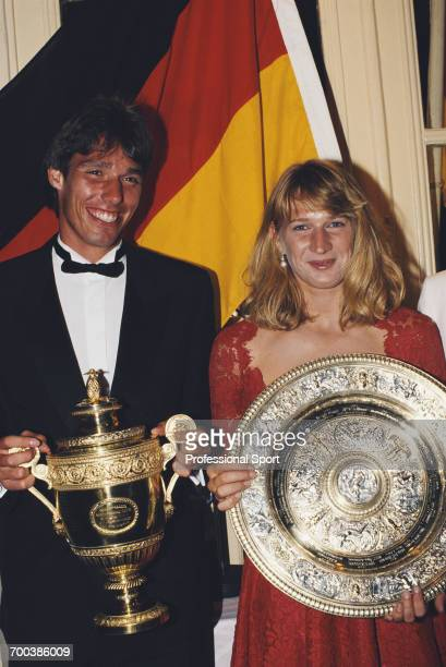 German tennis players Michael Stich men's singles champion at the 1991 Wimbledon Championships and Steffi Graf women's singles champion pictured...