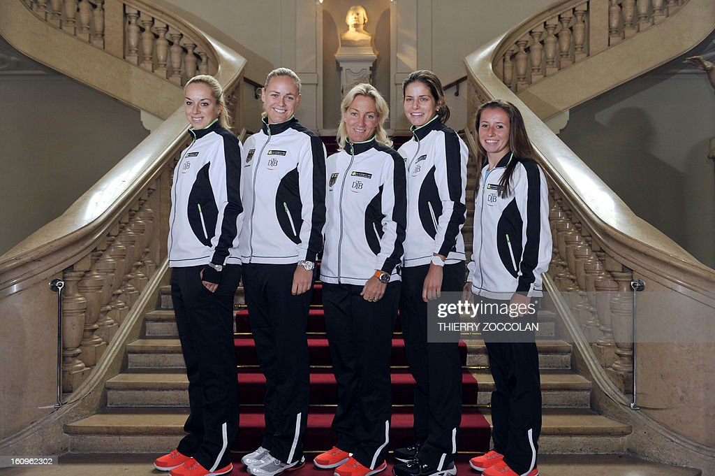 German tennis players (from L) Sabine Lisicki, Anna Lena Groenefeld, team captain Barbara Rittner, Julia Goerges and Annika Beck pose on February 8, 2013 prior to the draw for the Fed Cup World Group first round match against France held at Limoges' Town Hall. AFP PHOTO / THIERRY ZOCCOLAN